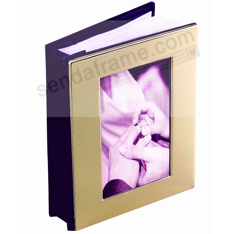 Gold-tone album with window cover holds 100 photos