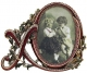 XO LOVE frame with Garnet and Ruby Crystals by Edgar Berebi�